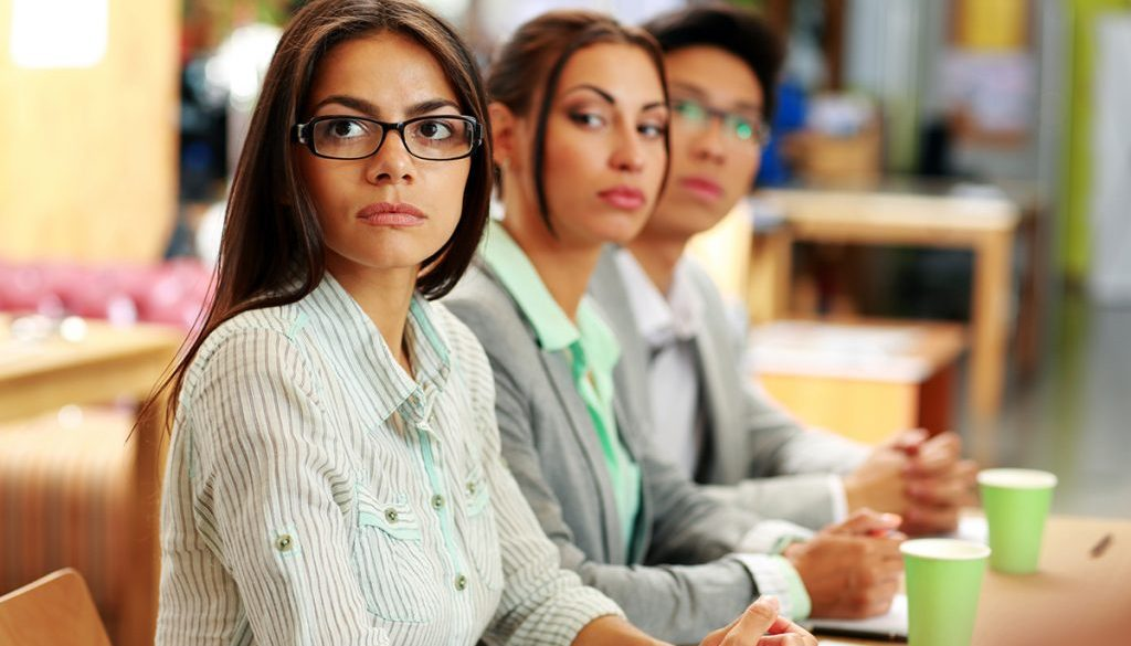 Business people sitting around a table during a meeting in office